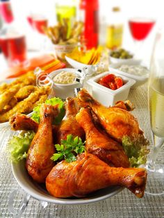 Party food with chicken drum sticks and tappas
