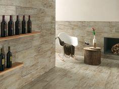 Ambientazione d'effetto con pavimento in gres porcellanato effetto legno.Collezione Metalwood.