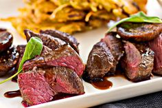 Venison medallions with figs and red wine syrup and potato rosti