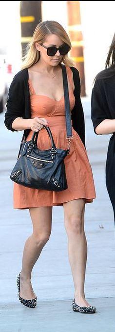Lauren Conrad: Purse – Balenciaga  Shoes – Christian Louboutin  sunglasses – Karen Walker