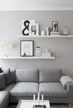 living room details, grey walls, from createcph. living room details, grey walls, from createcph. Shelves Above Couch, Living Room Shelves, Living Room Wall Decor Ideas Above Couch, Decor Above Sofa, Living Room Storage, White Floating Shelves, White Wall Shelves, Decorative Wall Shelves, Ikea Wall Shelves