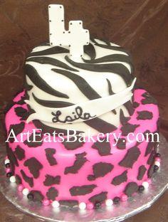 Two tier creative custom girl's animal print black, white and pink zebra and cheeta 4th birthday cake idea picture
