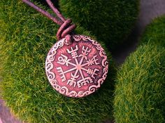 Our design of the Viking Compass is offered etched in red brass on a sliding, adjustable leather cord.