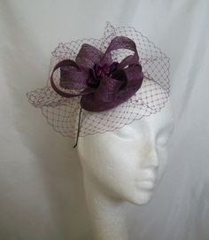 Pale Amethyst Gabrielle Blusher Veil Sinamay Loop & Pearl Fascinator Mini Hat. Order Now from www.indigodaisyweddings.co.uk Specialising in stunning bespoke cocktail fascinators and formal hats in a wide range of colours, perfect for Royal Ascot and The Kentucky Derby. Plus all your wedding floral accessories including shoe clips, vintage flapper bands, feather and flower fascinators, feather fans, fairy wands, wrist corsages, wedding bouquets & buttonholes. Worldwide Delivery.