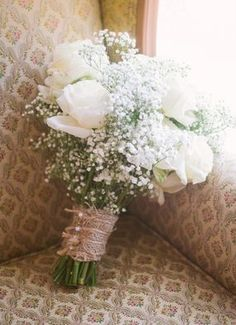 Rose and baby's breath switch the burlap for satin and pearl pins wrapped around the bouquet! :)