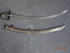 Relics of the War of 1812- A 19TH LIGHT DRAGOON OFFICER'S LIGHT CAVALRY SABRE. THIS STYLE OF SWORD WAS A PERSONAL PREFERENCE FOR MANY OFFICER'S WHO SERVED IN INDIA. IT HAS A HIGHLY CURVED, FLAT, UNFULLERED BLADE. THE DOUBLE EDGE POINTED BLADE IS ETCHED ON BOTH SIDES WITH AN ELEPHANT SURMOUNTED WITH A CROWN , ASSAYE AND XIX. THE GRIP IS ADORNED WITH FISH SKIN.