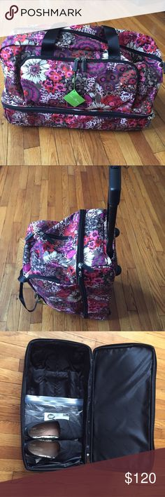 """NWT Vera Bradley Lighten Up Wheeled Carry On NWT Lighten Up carry on travel bag by Vera Bradley is in the print """"Rosewood"""" & it's gorgeous! The dimensions are 21""""x 14""""x 9"""", and it has a 6"""" drop handles in you'd prefer to carry it. Much more lightweight than a traditional carry on, water resistant material. Features a zip pocket inside the main compartment, and two slip pockets. The bottom compartment also zips; perfect for shoes or anything you'd prefer to keep separate! I also have the…"""