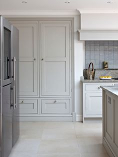 Large kitchen pantry cabinet exterior. Shaker style cabinets hand painted in 'Lead V' by Paint & Paper Library. Stone colour kitchen cabinets - grey/white.