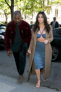 Kanye West and Kim Kardashian arrive at the Montaigne Market store in Paris on April 14, 2015. - Cosmopolitan.com