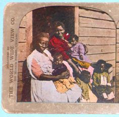 """Black Americana """"Down in Dixie"""" Stereoview.   Nobody is happy in this photograph.  One woman is breast feeding an infant.  I wonder if the photographer obtained her permission to photograph her."""