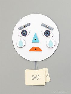 Learning about emotions is super fun with this DIY toy with changing faces! Download the template and create