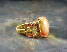Copper and Brass wire mixed to form this lovely ring with an Autumn Jasper stone is wrapped as the center piece. (SOLD) by AJewelryC