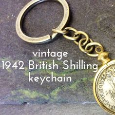This is a real collectors Keychain.   Hold in your hand a sterling silver British King George V, 1942 One Shilling coin, mounted in a Gold plated bezel, with a Silver tone antique bronze plated keychain. The perfect keepsake for all your valued keys.