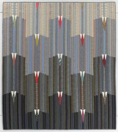 """City"" , 47 x 52"",  by Mary Fogg.  Made from reclaimed clothing:  suiting, serge, gabardine (woolens). 1990.  Quilt Index Record: 60-DC-19"