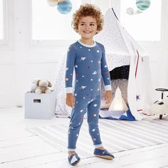 The White Company US. Space Print Pajamas Snug Fit   We love our space print pajamas – accented all-over with brightly colored planets and stars hurtling around the solar system. An ideal pick for aspiring little astrologers, the top has a long-sleeved design, while the matching trousers have an elasticated waistband and ribbed cuffs.