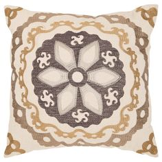 Bring exotic style to your sofa or favorite reading nook with this eye-catching linen and cotton pillow, featuring an embroidered suzani medallion motif.