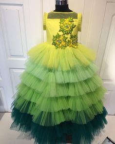 Shades a yellows to green a tiered gown gradiating from lemon yellow to green, emblisshed with self thread work butas… Party Wear Frocks, Kids Party Wear Dresses, Baby Girl Party Dresses, Little Girl Dresses, Long Frocks For Kids, Frocks For Girls, Baby Dress Design, Baby Girl Dress Patterns, Baby Dress Tutorials