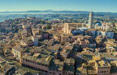 Siena, Italy - Hani Santosa/Shutterstock Siena Italy, Old Wall, Top Destinations, Hani, England Uk, Great Britain, Paris Skyline, Coastal, Most Beautiful
