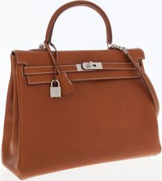 A one-of-a-kind Hermes special order Kelly bag, in Barenia leather with a Kiwi chevre leather interior, with brushed palladium hardware, with one-of-a-kind signifying horseshoe stamp.