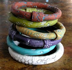 Polymer clay bangles by Anke H. aka Anart Island Studios. They are so earthy and all coordinate wonderfully.