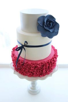 Hot pink raffles with navy blue flower