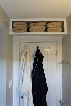 tips for decorating a small space, home decor, Look up for more storage We built this shelf over our bathroom door for our extra towels It was really easy