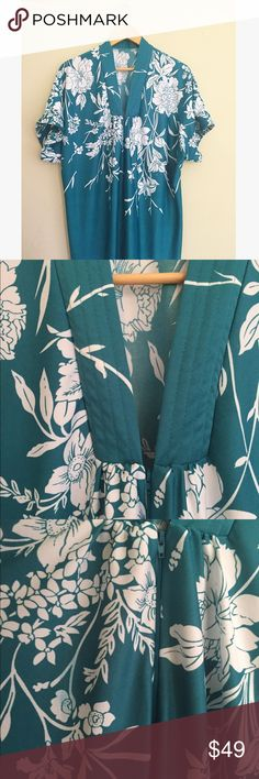 """Vintage Floral Muumuu Nightgown Stunning vintage nightie with white floral pattern and Japanese kimono style cut. Deep turquoise shade leans blue or green. Half zip with flowy fit and pockets. Some faint color bleeding is pictured in front and on the back near bottom hem. No size tag. Feels like polyester. Measures to a large, perfect as an oversized lounge piece as well! 55"""" long, 29"""" pit to pit. Measurements approximate, no trades, offers welcome! Vintage Intimates & Sleepwear Pajamas"""