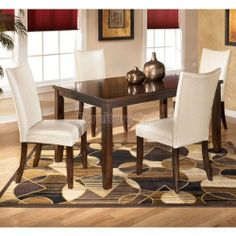 "Charrell Rectangular Dining Room Set with Ivory Chairs D357-25-02-set by Ashley Furniture. $667.75. The straight-line contemporary design of the ""Charrell"" dining room collection features a warm finish and the clean look of clear glass to perfectly capture a refreshing and exciting style to enhance your dining room decor. The medium brown finish of the exciting contemporary designed table base beautifully supports a clear glass table top featuring a beveled and poli..."