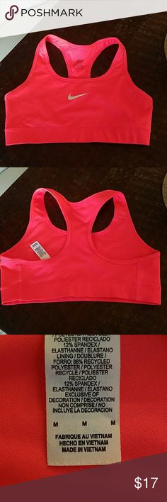 Nike sports bra- bright pink Never Worn! Size medium, bright pink color. Nike Tops