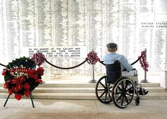 Pearl Harbor survivor Bill Johnson reads the list of names inscribed in the USS Arizona Memorial.