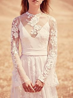 When it comes to all things bohemian, you cannot go past American store FREE PEOPLE. They have always showcased white and lacy numbers but recently I discovered their new 'Ever After' range, specifically for brides to be. With free international shipping on orders over $150USD (easily spent!) and the ability to return within 30 days for a refund (or after 30 days for a gift card) well, I can't see a reason not to check it out! Here are 10 of my favourite to get you started. Enjoy! xox