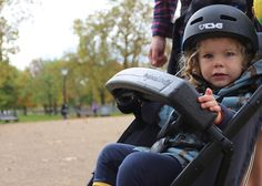 Your kid has to be at least one year old, can weigh a maximum  of 15kg and has to wear a helmet at all times. The Longboardstroller also has a standard five point pushchair harness for them to wear, as well as a double bumper bar. The Longboardstroller is steered by shifting your weight and you have a handbrake to slow / stop the Longboardstroller as well as a wrist band to connect you to the Longboardstroller during use.