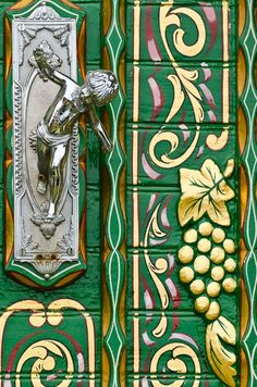 Love this Ornate Door on a gypsy wagon - grapes, color, and a silver cherub door handle. A twist of the rusted, green door and latch. Door Knobs And Knockers, Knobs And Handles, Door Handles, Cool Doors, Unique Doors, Gypsy Wagon, Gypsy Caravan, Door Detail, Door Accessories