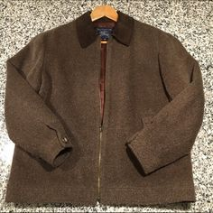 Vintage Burberry zip front jacket This is an oldie but a goodie. Vintage Burberry Wool/Mohair blend zipper front jacket features two front pockets with button closure. In perfect condition. No wear to the liner! Don't let this one pass you by. Burberry Jackets & Coats