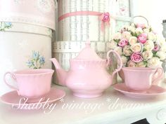 love pink tea pot and tea cups with hat boxes in back ground