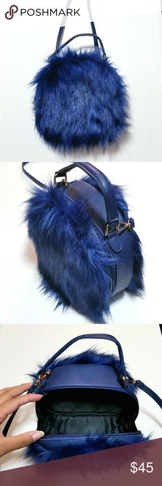 "Navy Faux Fur Dome Case Crossbody NWOT - 7"" H  x 8"" W x 3"" D Navy Faux Fur W/Black Tones PVC Center & Strap Buckle Detail on Strap (Removable) Top Handle, Two Zipper Pulls Gold Hardware Finish  Polyester Interior Lining Nasty Gal Bags Crossbody Bags"