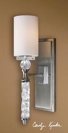 This little light shines bright with style and will feel just as home as a bedside lamp, lighting up your bathroom or illuminating your hallway. http://www.myswankyhome.com/campania-1-light-carved-glass-wallsconce/
