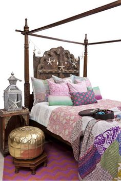 Style Inspiration.  Deep purple and pink kantha bedding (cushions and throw) compliment the deeply warm and rustic feel of a wooden bed.