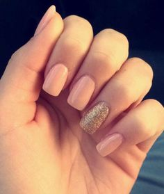 Nude pink acrylic with gold glitter