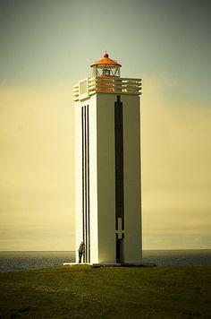 Beautiful art deco style lighthouse in Kálfshamarsvík, Iceland, by Vilhjálmur Ingi Vilhjálmsson.
