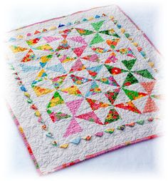 Nothing says spring more than a snowbound quilt. The Dream On  line of fabric reminds me more of spring than say.........uh, winter.   But ...