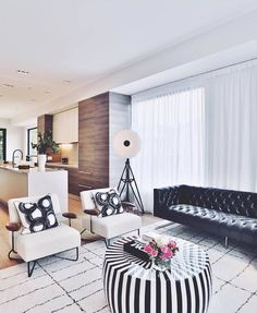 Our Black Nobility Leather Sofa and B/W Striped Coffee Table via Christine Dovey