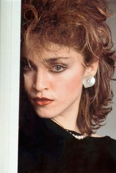 You don't see too many photos of Madonna as a redhead. Looks great! This one is from Tom Morillo, 1982.
