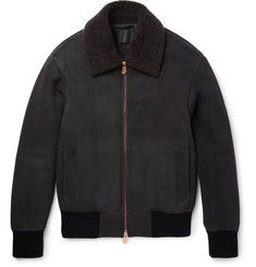 This combination of practicality and sartorial worth is evident in Berluti's take on the bomber jacket. Worked by skilled hands in Italy, this beautifully made piece is constructed from plush grey sheepskin that's guaranteed to ward off the chill. The copper-tone hardware is a testament £3,900