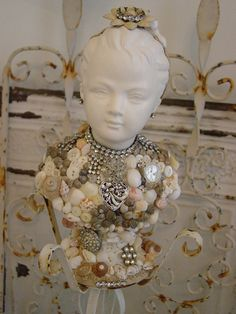 bust with shells, jewels