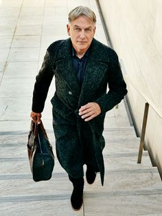 Alpaca and virgin wool coat by Giorgio Armani ($4,695); silk shirt by Brioni ($1,625); wool trousers by Ascot Chang ($995); leather shoes by Esquivel ($950); bag by Graf & Lantz ($379).