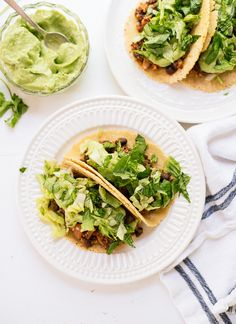 These quinoa and black bean tacos with avocado crema are a simple and delicious weeknight dinner! They're vegan and gluten free, too. Make some tonight! @CookieandKate