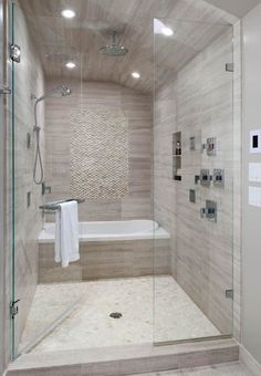 Master bathroom. Bath tub in shower. Home.