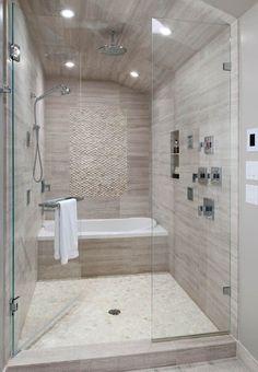 Master bathroom. Bath tub in shower. Home.