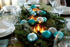 Table centerpiece by Brooklyn Limestone @ http://www.brooklynlimestone.com/2012/01/wrapping-up-christmas-winner.html